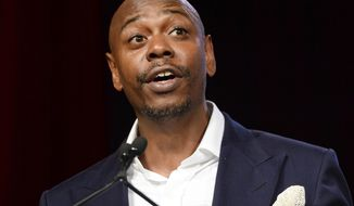 Comedian Dave Chappelle speaks at the RUSH Philanthropic Arts Foundation's Art for Life Benefit in New York, July 18, 2015. Mr. Chappelle celebrated the release of a pair of Netflix comedy specials on Tuesday, March 21, 2017, with some high-profile friends at a Hollywood club. (Photo by Scott Roth/Invision/AP, File)