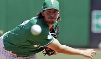FILe - In this March 17, 2017, file photo, Philadelphia Phillies starting pitcher Aaron Nola throws against the Toronto Blue Jays in the first inning of a spring training baseball game, in Clearwater, Fla. Nola was headed toward ace status until an elbow injury put everything on hold. (AP Photo/John Raoux, File)