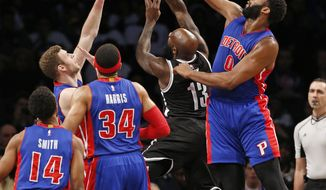 Detroit Pistons center Andre Drummond (0) defends Brooklyn Nets forward Quincy Acy (13) during the first half of an NBA basketball game, Tuesday, March 21, 2017, in New York. (AP Photo/Kathy Willens)