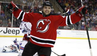 New Jersey Devils center John Quenneville celebrates after scoring his first NHL goal during the second period of an NHL hockey game against the New York Rangers, Tuesday, March 21, 2017, in Newark, N.J. (AP Photo/Julio Cortez)