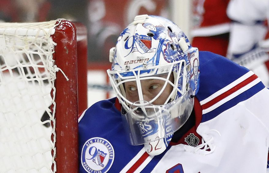 New York Rangers goalie Antti Raanta, of Finland, eyes the puck as it enters on a scoring shot by New Jersey Devils left wing Taylor Hall during the second period of an NHL hockey game, Tuesday, March 21, 2017, in Newark, N.J. (AP Photo/Julio Cortez)