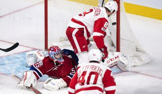 Detroit Red Wings' Justin Abdelkader (8) scores past Montreal Canadiens goalie Al Montoya during the first period of an NHL hockey game in Montreal on Tuesday, March 21, 2017. (Paul Chiasson/The Canadian Press via AP)