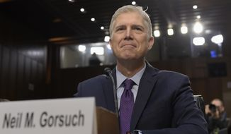 Supreme Court Justice nominee Neil Gorsuch prepares to testify on Capitol Hill in Washington, Tuesday, March 21, 2017, at his confirmation hearing before the Senate Judiciary Committee. (AP Photo/Susan Walsh)