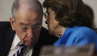 Senate Judiciary Committee Chairman Sen. Charles Grassley, R-Iowa confers with the committee's ranking member Sen. Dianne Feinstein, D-Calif. on Capitol Hill in Washington, Monday, March 20, 2017, during the committee's confirmation hearing for Supreme Court Justice nominee Neil Gorsuch. (AP Photo/Pablo Martinez Monsivais)