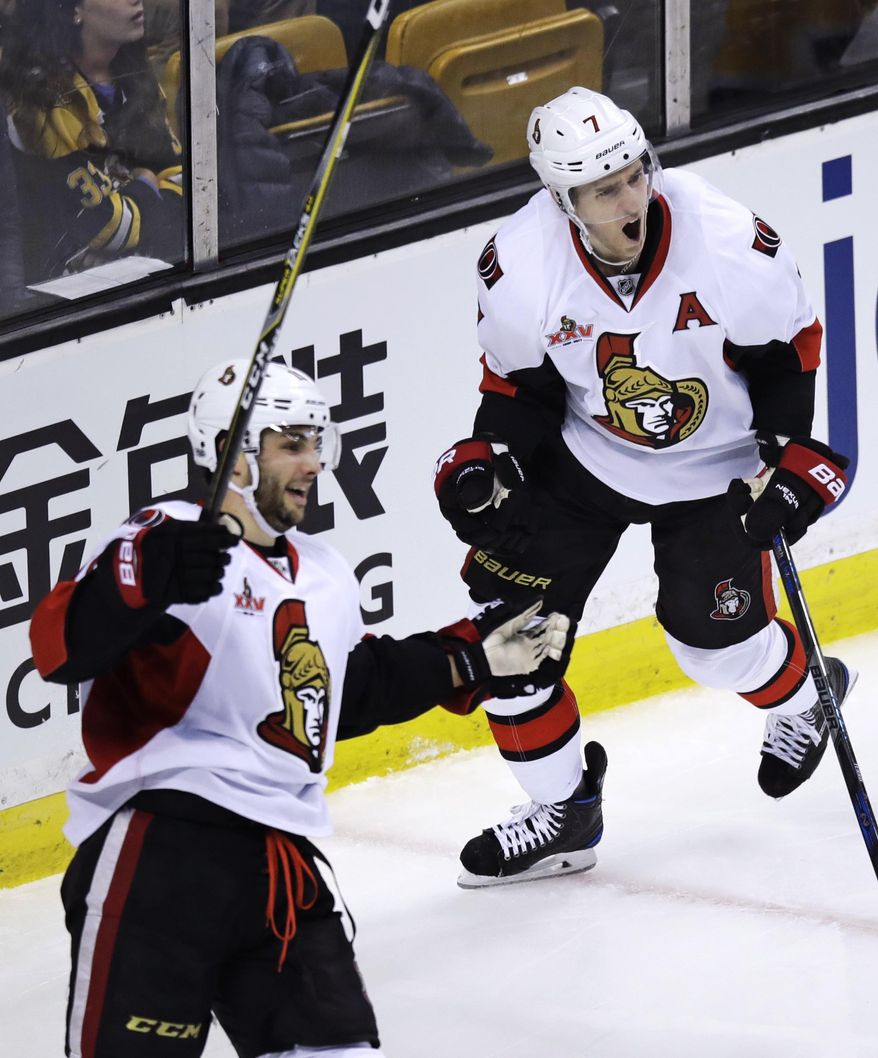 Ottawa Senators center Kyle Turris, right, celebrates after his go-ahead goal, breaking a 2-2 tie, against the Boston Bruins during the third period of an NHL hockey game in Boston, Tuesday, March 21, 2017. The Senators defeated the Bruins 3-2. At left is Ottawa Senators center Derick Brassard. (AP Photo/Charles Krupa)