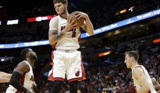 Miami Heat's Tyler Johnson (8) grabs a rebound during the first half of an NBA basketball game against the Phoenix Suns, Tuesday, March 21, 2017, in Miami. (AP Photo/Lynne Sladky)