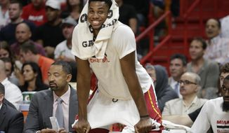 Miami Heat's Hassan Whiteside watches from the bench during the second half of an NBA basketball game against the Phoenix Suns, Tuesday, March 21, 2017, in Miami. The Heat won 112-97. (AP Photo/Lynne Sladky)