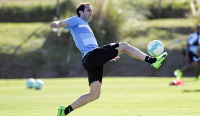 Uruguay's Diego Godin controls the ball during a training session of the national soccer team in the outskirts of Montevideo, Uruguay, Monday, March 20, 2017. Uruguay will face Brazil in a 2018 World Cup qualifying soccer match in Montevideo on March 23. (AP Photo/Matilde Campodonico)