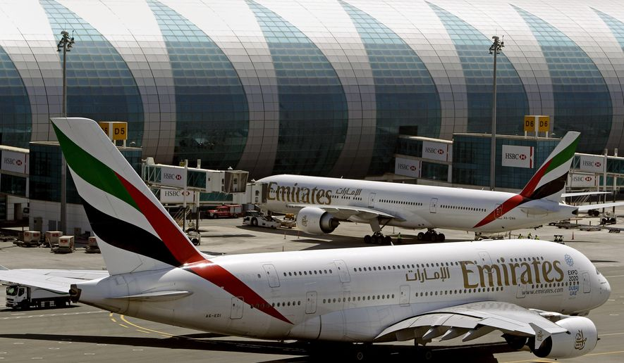 FILE - This May 8, 2014 file photo shows Emirates passenger planes at Dubai airport in United Arab Emirates. The U.S. government is temporarily barring passengers on certain flights originating in eight other countries from bringing most types of electronics in their carry-on luggage. A U.S. official tells The Associated Press that the ban beginning Tuesday, March 21, 2017, affects airports in 10 cities of Cairo in Egypt; Amman in Jordan; Kuwait City in Kuwait; Casablanca in Morocco; Doha in Qatar; Riyadh and Jeddah in Saudi Arabia; Istanbul in Turkey; and Abu Dhabi and Dubai in the United Arab Emirates. in the Middle East, North Africa and Turkey. (AP Photo/Kamran Jebreili, File)