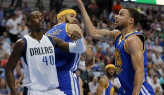 Golden State Warriors guard Stephen Curry (30) throws up a shot as Dallas Mavericks' Harrison Barnes (40) watches in the first half of an NBA basketball game, Tuesday, March 21, 2017, in Dallas. (AP Photo/Tony Gutierrez)