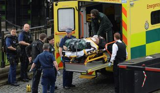 "The attacker outside the Houses of Parliament in London on Wednesday was treated by emergency services but died as a result of gunshot wounds from city police. Authorities say they are treating the incident ""as a terrorist incident until we know otherwise."" (Associated Press)"