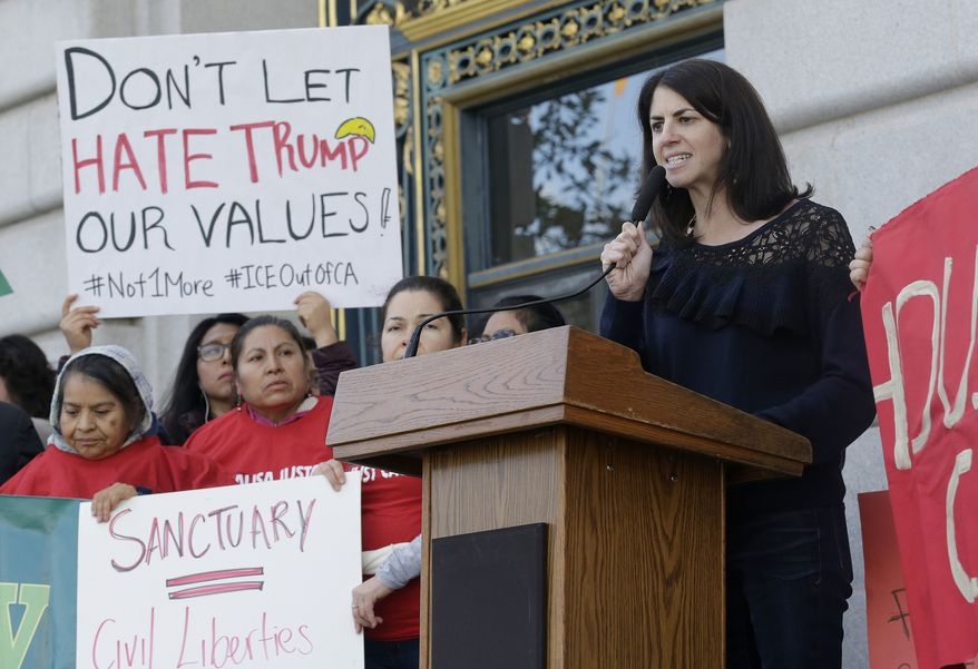 "Supervisor Hillary Ronen speaks at a rally outside of City Hall in San Francisco, Wednesday, Jan. 25, 2017. President Donald Trump moved aggressively to tighten the nation's immigration controls Wednesday, signing executive actions to jumpstart construction of his promised U.S.-Mexico border wall and cut federal grants for immigrant-protecting ""sanctuary cities."" (AP Photo/Jeff Chiu)"