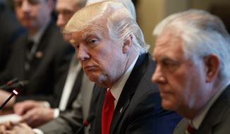 President Trump listens as Iraqi Prime Minister Haider al-Abadi speaks during a meeting in the Cabinet Room of the White House in Washington. In an eventful week of politics, Mr. Trump will need to restore his credibility so he can handle the next crisis, says Matt Mackowiak. (AP Photo/Evan Vucci, File)