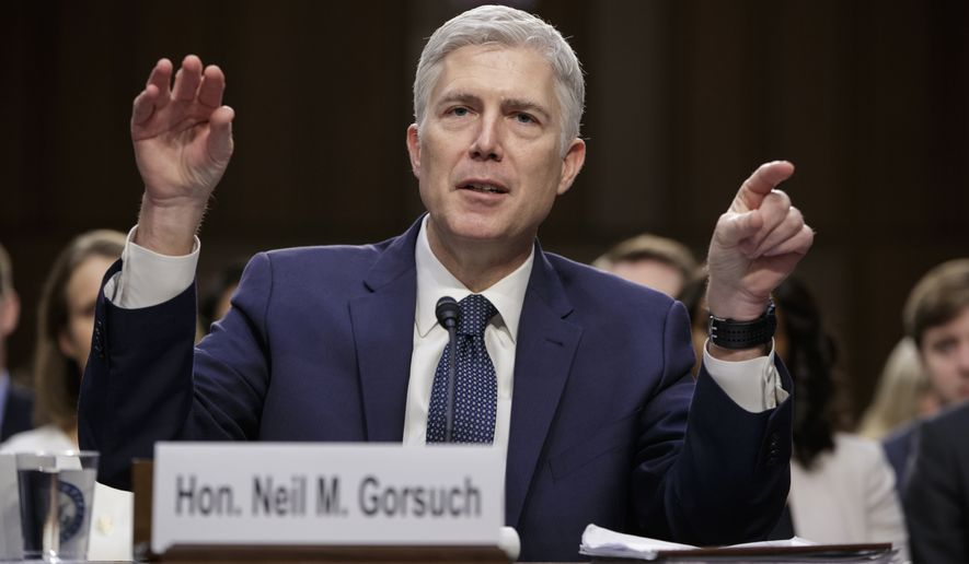 Supreme Court Justice nominee Neil Gorsuch testifies on Capitol Hill in Washington, Wednesday, March 22, 2017, at his confirmation hearing before the Senate Judiciary Committee.  (AP Photo/J. Scott Applewhite)