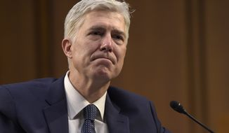 Supreme Court Justice nominee Neil Gorsuch listens as he is asked a question by Sen. Mazie Hirono, D-Hawaii, on Capitol Hill in Washington, Wednesday, March 22, 2017, during his confirmation hearing before the Senate Judiciary Committee. (AP Photo/Susan Walsh)