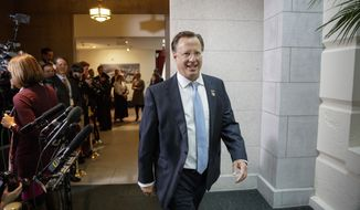 Rep. Dave Brat, R-Va., a member of the conservative Freedom Caucus, arrives for the meeting of the Republican Conference with President Donald Trump as he rallied support for the GOP health care bill at the Capitol, in Washington, Tuesday, March 21, 2017. Trump has been trying to persuade reluctant members of the Freedom Caucus to get behind the bill. (AP Photo/J. Scott Applewhite)