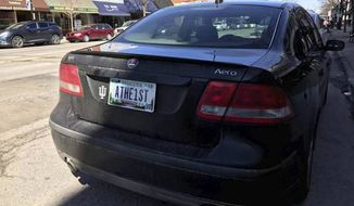"""Photo of car owned by Indiana man Chris Bontrager bearing an """"Athe1st"""" vanity plate. Mr. Bontrager was initially denied the license plate but won an appeal after enlisting the aid of the ACLU. (Chris Bontrager/Elkhart Truth) [http://www.elkharttruth.com/news/goshen-man-receives-athe-st-license-plate-after-appealing-bmv/article_e73bd86c-c813-586e-ab3f-e4ab70980526.html]"""