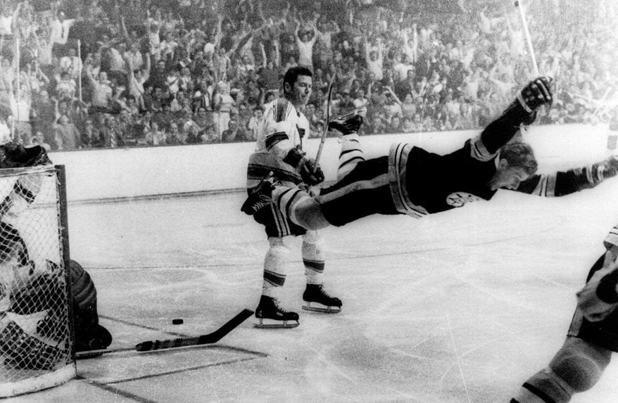 FILE - In this May 10, 1970, file photo, Boston Bruins' Bobby Orr goes into orbit after scoring the goal against the St. Louis Blues that won the Stanley Cup for the Bruins in Boston. Barry Meisel, president of the MeiGroup, has authenticated game-worn sports memorabilia since 1997. His company was once asked by a collector to authenticate a jersey that an auction house was purporting to have been worn by Boston Bruins great Bobby Orr the night they captured the 1972 Stanley Cup. (Ray Lussier/The Boston Herald via AP, File)