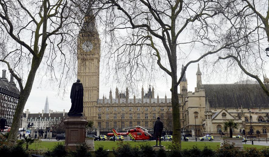 Police on the scene after sounds similar to gunfire have been heard close to the Houses of Parliament, London, Wednesday, March 22, 2017. The U.K. House of Commons sitting has been suspended as witnesses report sounds like gunfire outside. (Victoria Jones/PA via AP) ** FILE **