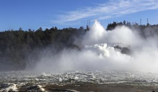 "FILE - In this Feb. 14, 2017, file photo water gushes from the Oroville Dam's main spillway in Oroville, Calif. A team of experts is warning of a ""very significant risk"" if the main spillway of the California dam is not operational again by the next rainy season. The warning is contained in a report obtained Wednesday, March 22 by The Associated Press. (AP Photo/Marcio Jose Sanchez, File)"