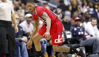 Washington Wizards guard Bradley Beal (3) steals the ball from Atlanta Hawks guard Dennis Schroeder (17) during the first half of an NBA basketball game Wednesday, March 22, 2017, in Washington. (AP Photo/Alex Brandon)