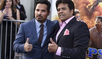 "Michael Pena, left, and Erik Estrada pose at the Los Angeles premiere of ""CHIPS"" at the TCL Chinese Theatre on Monday, March 20, 2017. (Photo by Jordan Strauss/Invision/AP)"