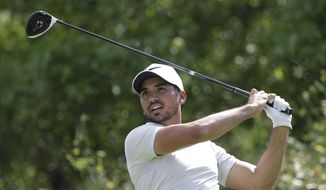 Jason Day, of Australia, watches his tee shot on the sixth hole during round-robin play against Pat Perez at the Dell Technologies Match Play golf tournament at Austin County Club, Wednesday, March 22, 2017, in Austin, Texas. Day conceded the match after the sixth hole and withdrew from the tournament. (AP Photo/Eric Gay)