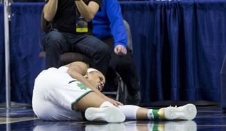 FILE - In this Sunday, March 19, 2017, file photo, Notre Dame's Brianna Turner reacts to a knee injury during the first half of a second-round game against Purdue in the NCAA college basketball tournament in South Bend, Ind. Top-seeded Notre Dame tries to prepare for its Sweet 16 game against Ohio State after losing leading scorer Brianna Turner for the season and with Kathryn Westbeld hobbling on a bad ankle.  (AP Photo/Robert Franklin, File)