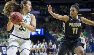 FILE - In this Sunday, March 19, 2017, file photo, Notre Dame's Kathryn Westbeld (33) looks to pass around Purdue's Dominique Oden (11) during a second-round game in the NCAA college basketball tournament in South Bend, Ind. Top-seeded Notre Dame tries to prepare for its Sweet 16 game against Ohio State after losing leading scorer Brianna Turner for the season and with Kathryn Westbeld hobbling on a bad ankle. (AP Photo/Robert Franklin, File)