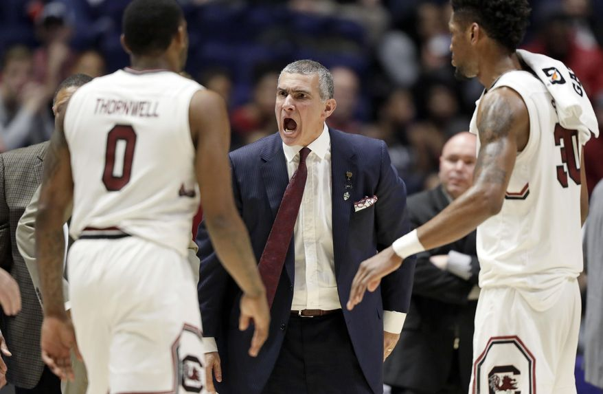 FILE - In this Friday, March 10, 2017, file photo, South Carolina head coach Frank Martin yells at guard Sindarius Thornwell (0) during the second half of an NCAA college basketball game against Alabama at the Southeastern Conference tournament in Nashville, Tenn. (AP Photo/Wade Payne, File) **FILE**