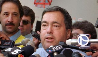 In this Oct. 2, 1995, file photo, Chicago Bulls general manager Jerry Krause speaks to the media in Deerfield, Ill., about trading center Will Perdue for the flamboyant San Antonio Spurs' Dennis Rodman. Krause, the executive behind the Bulls' six NBA titles, has died, the team announced Tuesday, March 21, 2017. He was 77.  (AP Photo/Michael S. Green, File)