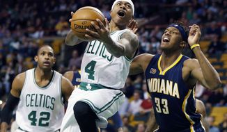 Boston Celtics' Isaiah Thomas (4) goes up to shoot against Indiana Pacers' Myles Turner (33) during the first quarter of an NBA basketball game in Boston, Wednesday, March 22, 2017. (AP Photo/Michael Dwyer)