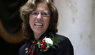 FILE- In this March 19, 2013, file photo, photo Rhode Island Senate President Teresa Paiva Weed smiles while at the rostrum in the Senate Chamber at the Statehouse in Providence, R.I. Paiva Weed is stepping down from the Senate for a job leading a hospital industry group, she announced on Wednesday, March 22, 2017. (AP Photo/Steven Senne, File)