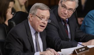 Senate Judiciary Committee member Sen. Richard Durbin, D-Ill., left, joined by Sen. Sheldon Whitehouse, D-R.I., questions Supreme Court Justice nominee Neil Gorsuch, on Capitol Hill in Washington, Wednesday, March 22, 2017, during the committee's confirmation hearing for Gorsuch. (AP Photo/J. Scott Applewhite)