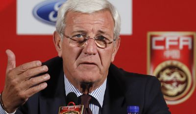 FILE - In this Oct. 28, 2016, file photo, China's national football team coach Marcello Lippi speaks during a news conference at a hotel in Beijing. Lippi faces his biggest challenge yet as China coach as the 2006 World Cup winner faces South Korea needing a win to keep any hopes of qualifying for Russia 2018 alive. China, which has appeared at just one World Cup back in 2002, is in last place in Group A with just two points from the five games in the third round of qualification so far. Lippi was appointed in October and needs goals from a team that has failed to score in all four games since losing 3-2 to Korea in Seoul in September. (AP Photo/Andy Wong, File)