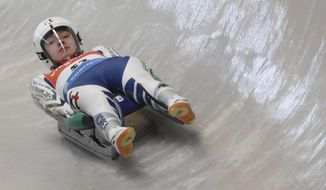 In this Thursday, Feb. 16, 2017 photo, naturalized luge athlete Aileen Frisch speeds down the track during the official training for the Luge World Cup competition at the Alpensia Sliding Centre in Pyeongchang, South Korea. South Korea has recruited foreign-born athletes in recent years to flesh out its roster as it prepares to host the 2018 Winter Olympics. (Lee Jin-wook/Yonhap via AP)