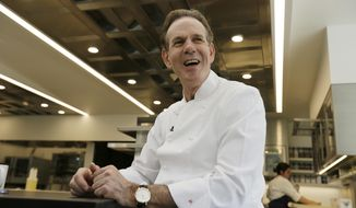 In this photo taken Thursday, March 9, 2017, chef Thomas Keller smiles during an interview in his new kitchen at the French Laundry restaurant in Yountville, Calif. The celebrated chef Keller has just opened a state-of-the art new kitchen at his famed French Laundry after spending $10 million on an extensive renovation. At 61 years old, Keller entertains the thought of slowing down. Just not right now. (AP Photo/Eric Risberg)
