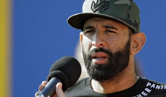 Toronto Blue Jays slugger Jose Bautista speaks to the media before a spring training baseball game against the Detroit Tigers, Wednesday, March 22, 2017, in Dunedin, Fla. Bautista is back in camp with the Blue Jays after playing in the World Baseball Classic. (AP Photo/Chris O'Meara)