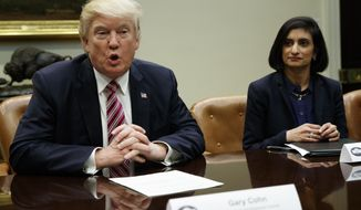 Administrator of the Centers for Medicare and Medicaid Services Seema Verma listens at right as President Donald Trump speaks during a meeting on women in healthcare, Wednesday, March 22, 2017, in the Roosevelt Room of the White House in Washington. (AP Photo/Evan Vucci)