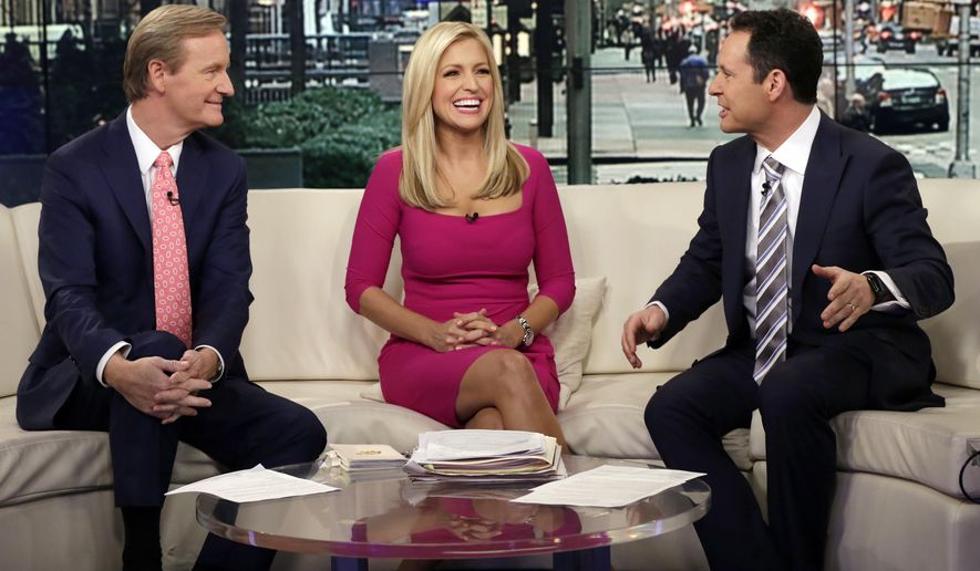 """In this Feb. 29, 2016, file photo, co-hosts  Steve Doocy, from left, Ainsley Earhardt and Brian Kilmeade appear on the morning show """"Fox & Friends"""" in New York. During a phone interview on the Sept. 15, 2020, edition of the program, President Trump announced he would be appearing weekly on the program, something that seemed to be news to program co-host Steve Doocy. (AP Photo/Richard Drew, File)  ** FILE **"""