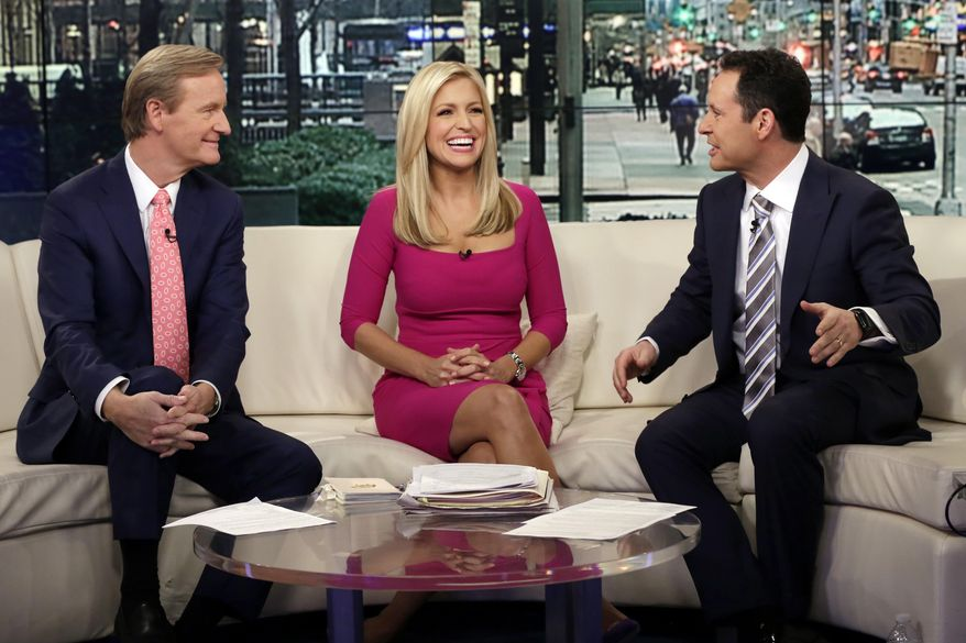 "In this Feb. 29, 2016, file photo, co-hosts  Steve Doocy, from left, Ainsley Earhardt and Brian Kilmeade appear on the morning show ""Fox & Friends"" in New York. During a phone interview on the Sept. 15, 2020, edition of the program, President Trump announced he would be appearing weekly on the program, something that seemed to be news to program co-host Steve Doocy. (AP Photo/Richard Drew, File)  ** FILE **"