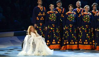 FILE In this Friday, March 7, 2014 file photo, Yulia Samoylova  sits on stage during the opening ceremony of the 2014 Paralympic Games in Sochi, Russia. Ukraine's security service says it has prepared documents to ban Russia's contestant from this year's Eurovision song contest, but that a final decision has not been made. Russia chose Yulia Samoylova to represent the country in 2017's May 11-13 contest in Kiev. (AP Photo/Ekaterina Lyzlova, File)