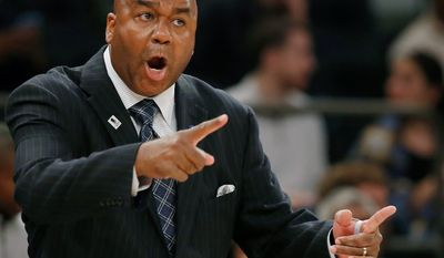 FILE - In this Nov. 22, 2015, file photo, Georgetown head coach John Thompson III gestures toward his players during the first half of an NCAA college basketball game against Duke at Madison Square Garden in New York. Georgetown has fired basketball coach John Thompson III on Thursday, March 23, 2017, after two consecutive losing seasons at the school his father led to a national championship. (AP Photo/Kathy Willens, File)
