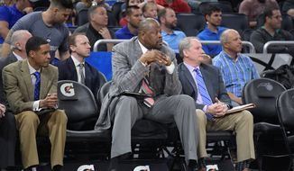 Former Hoya Patrick Ewing, 55, is currently an assistant coach with the NBA's Charlotte Hornets and could be the favorite to land the Georgetown job should he be interested. (Associated Press).