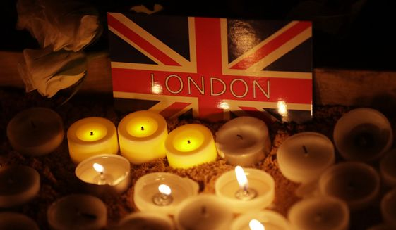 A candlelight vigil was held Thursday for the victims of Wednesday's attack at Trafalgar Square in London. (Associated Press)