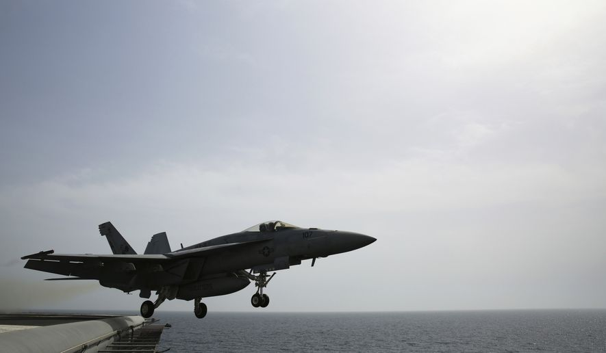 In this Wednesday, March 22, 2017 photograph, an F-18 is launched off the USS George H.W. Bush as it travels through the Persian Gulf. The carrier soon will begin launching airstrikes targeting the Islamic State group in Iraq and Syria. (AP Photo/Jon Gambrell)