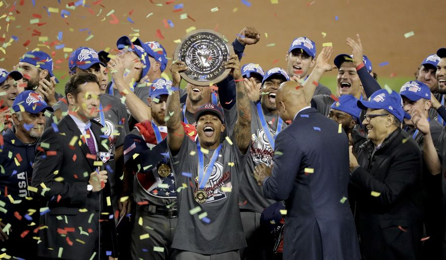 U.S. pitcher Marcus Stroman holds up with his MVP trophy after the United State defeated Puerto Rico 8-0 in the final of the World Baseball Classic in Los Angeles, Wednesday, March 22, 2017. (AP Photo/Jae C. Hong)