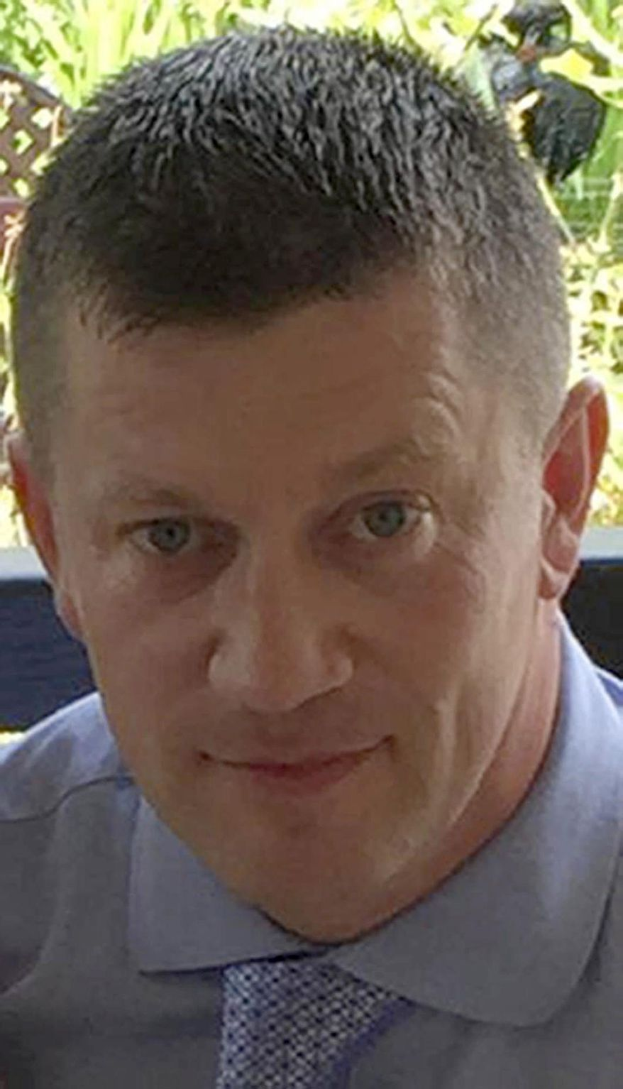 "Undated handout photo released by Metropolitan Police on Wednesday, March 22, 2017 of police officer Keith Palmer who was killed during the attack on the Houses of Parliament in London. A knife-wielding man went on a deadly rampage in the heart of Britain's seat of power Wednesday, plowing a car into pedestrians on London's Westminster Bridge before stabbing a police officer to death inside the gates of Parliament. Five people were killed, including the assailant, and 40 others were injured in what Prime Minister Theresa May condemned as a ""sick and depraved terrorist attack."" (Metropolitan Police via AP)"
