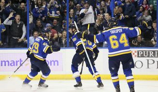 St. Louis Blues left wing Magnus Paajarvi, center, reacts after center Ivan Barbashev, left, and right wing Nail Yakupov both assisted on his goal in the first period against the Vancouver Canucks, in an NHL hockey game Thursday, March 23, 2017, in St. Louis. (Chris Lee/St. Louis Post-Dispatch via AP)