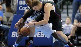 Dallas Mavericks forward Harrison Barnes (40) steals the ball away from Los Angeles Clippers' Blake Griffin (32) in the final seconds of an NBA basketball game in Dallas, Thursday, March 23, 2017. The Mavericks won 97-95. (AP Photo/Tony Gutierrez)